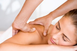 Woman getting a massage at spa